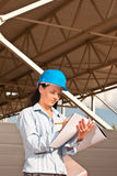 Young engineer at  construction site. With building project Royalty Free Stock Photo