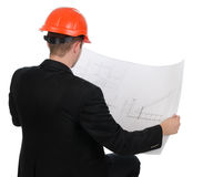 Young engineer consulting a building plan Stock Photos