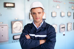 Young engineer at control room Royalty Free Stock Photos