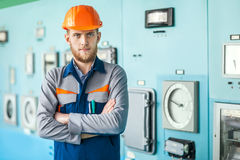 Young engineer at control room in factory Royalty Free Stock Photo