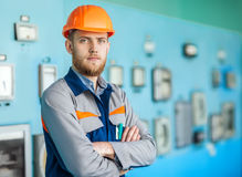 Young engineer at control room in factory Stock Image
