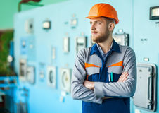 Young engineer at control room in factory Royalty Free Stock Image