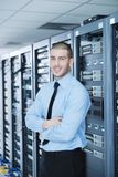 Young it engineer in datacenter server room Royalty Free Stock Image