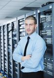 Young it engineer in datacenter server room Stock Photography