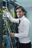 Young it engineer in datacenter server room Royalty Free Stock Photography