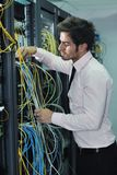 Young it engineer in datacenter server room Royalty Free Stock Photos