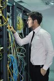 Young it engineer in datacenter server room Stock Image