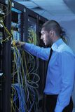 Young it engineer in datacenter server room Royalty Free Stock Photo