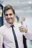 Young it engineer in datacenter server room Stock Photo