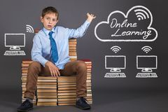 The young engineer demonstrates the principle of distance learning. Online education concept. The young engineer demonstrates the principle of distance learning Royalty Free Stock Photography