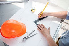 Young engineer is designing a plan of construction Royalty Free Stock Photo