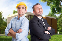 Young engineer and entepreneur in front of house Royalty Free Stock Photos