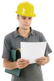 Young engineer with hardhat. Studying the project Royalty Free Stock Photography
