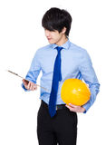 Young engineer hold with protective helmet and clipboard. Isolated on white background Stock Photography