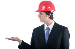 Young engineer holding imagined object on his palm Royalty Free Stock Images