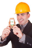 Young engineer with hourglass Stock Photo