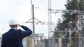 A young engineer, an inspector, inspects checks a power plant. Inspection stock footage