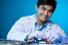 Young engineer. Isolated portrait of a young engineer smiling and posing on the foreground Royalty Free Stock Photo