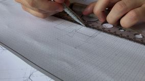 A young engineer learns to work with charts. Close up drawing, macro graphics stock video