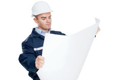 Young engineer looking at blueprint Royalty Free Stock Images