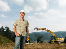 Young engineer looking at construction in progress Stock Image