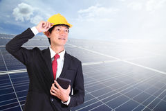 Young engineer man standing in front solar energy on blue sky cl. Solar panels. Young engineer man standing in front Solar energy.Power plant using renewable Stock Photography