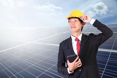 Young engineer man standing in front solar energy on blue sky cl. Solar panels. Young engineer man standing in front Solar energy.Power plant using renewable Royalty Free Stock Photo