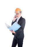 Young engineer man wearing orange helmet talking via mobile phone Stock Image