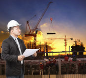Young engineer man working with construction plan in building st Stock Photo