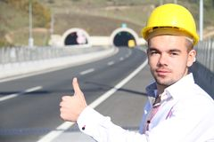 Young engineer near the tunnel. Photo of the Young engineer near the tunnel Stock Photos