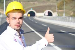 Young engineer near the tunnel. Photo of the Young engineer near the tunnel Stock Image