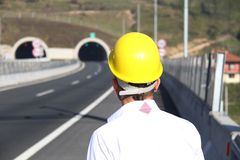 Young engineer near the tunnel. Photo of the Young engineer near the tunnel Stock Photo