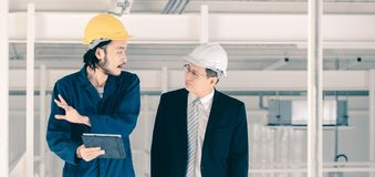 Young engineer present work to executive engineer stock image