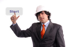 Young Engineer, presses the Start button. Isolated in white background stock image