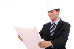 Young Engineer, reading a plan Royalty Free Stock Images