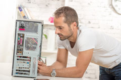 Young engineer repaired  computer Royalty Free Stock Images