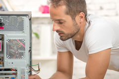 Young engineer repaired a computer Stock Image