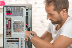 Young engineer repaired a computer Royalty Free Stock Photos