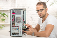 Young engineer repaired a computer Royalty Free Stock Photo