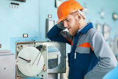 Young engineer repairing equipment at control room Royalty Free Stock Image