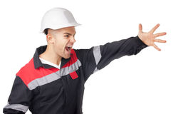 Young engineer shouts having raised a hand Royalty Free Stock Photos