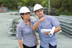 Young engineer shows student around the site Stock Photos