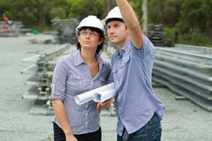 Young engineer shows student around the site Stock Images