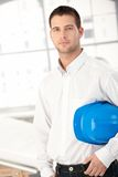 Young engineer standing in bright office Stock Photography