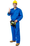 Young engineer with thumb up sign Royalty Free Stock Photos