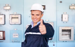 Young engineer with thumbs up at control room. Portrait of young engineer with thumbs up at control room Royalty Free Stock Photography