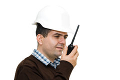 Young engineer using radio to communicate. Isolated on white Stock Photography