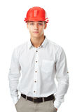 Young engineer wearing red helmet standing Royalty Free Stock Photos