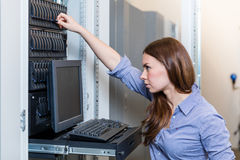 Young engineer woman works behind the management console Royalty Free Stock Photos