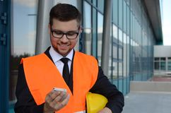 Young engineer at work. Portrait of a young engineer at work outdoors Royalty Free Stock Image